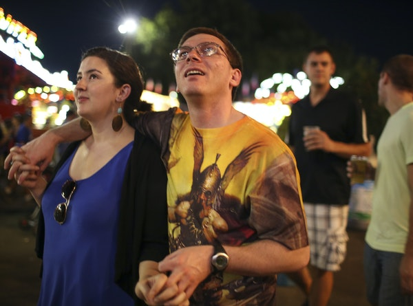Damon Thibodeaux and his girlfriend, Veronika Castellanos strolled down the Midway during their first visit to the Minnesota State Fair. JEFF WHEELER