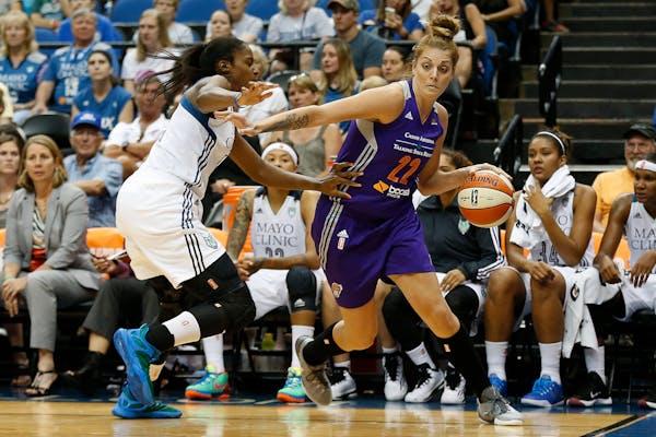 Phoenix Mercury center Cayla Francis (22) drives the ball around Minnesota Lynx forward Devereaux Peters.