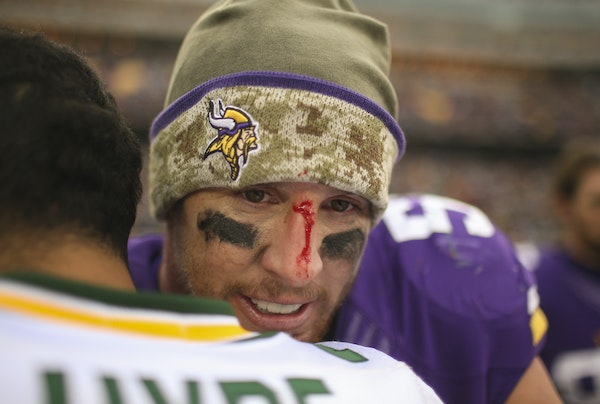 A bloodied Vikings outside linebacker Chad Greenway had a hug for Green Bay free safety Micah Hyde after the Nov. 23, 2014, game at TCF Bank Stadium.