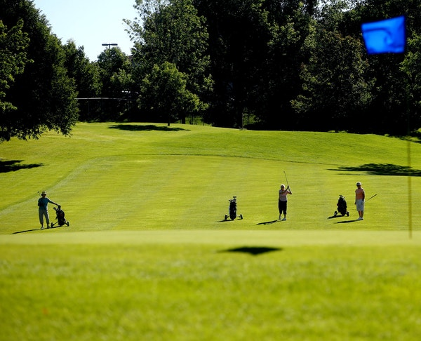Women's golf league members play a round at Bloomington's Hyland Greens golf course July 28. The course has been operating in the red since 2005.