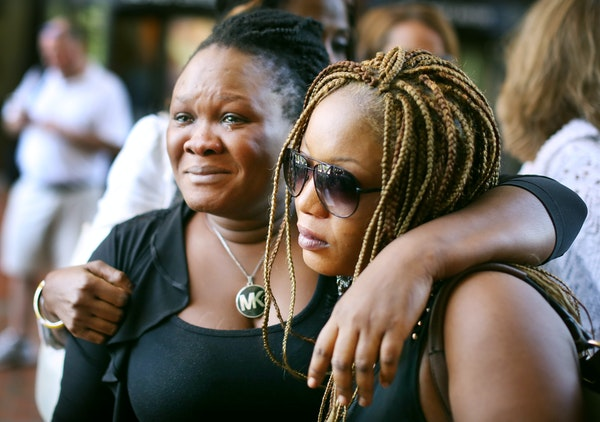 Barway Collins' mother, Louise Karluah, left, and his stepmother, Yamah Collins, hugged each other after attending the Monday court hearing.