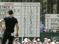 Martin Kaymer, of Germany, looks at his name on top of the leaderboard on the second hole during the second round of the U.S. Open golf tournament in