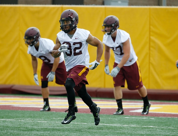 Minnesota running back Berkley Edwards (32) takes part in a drill during NCAA college football training camp in Minneapolis Friday, Aug. 7, 2015. (AP