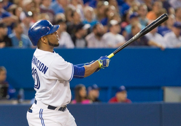 Toronto Blue Jays' Edwin Encarnacion watches his three-run home run against the Minnesota Twins during the fourth inning of a baseball game Wednesday,