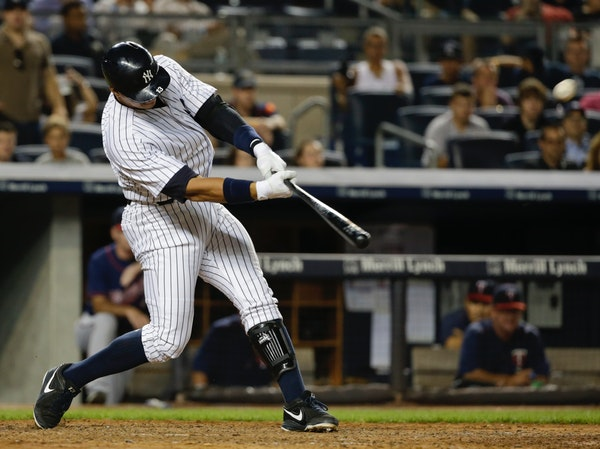 New York Yankees' Alex Rodriguez hits a grand slam during the seventh inning of a baseball game against the Minnesota Twins on Tuesday, Aug. 18, 2015,