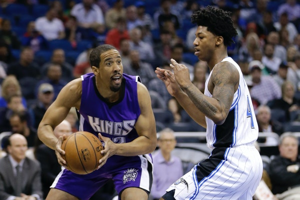 Andre Miller, left, played for Sacramento and Washington last season. He joins the Timberwolves to add a veteran's presence at point guard.