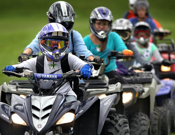 ATV riders, like these at a training course in Farmington, can now take their machines on a stretch of the Gunflint Trail in Cook County.