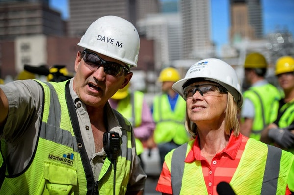 Dave Mansell, general manager of the stadium project for Mortensen and Michele Kelm-Helgen, chair of the Minnesota Sports Facilities Authority, toured