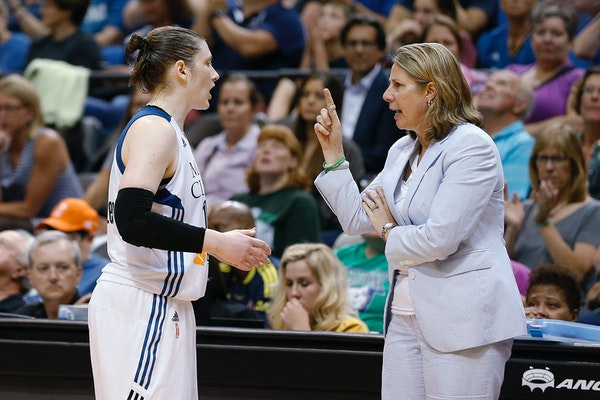 Minnesota Lynx guard Lindsay Whalen talks with coach Cheryl Reeve.