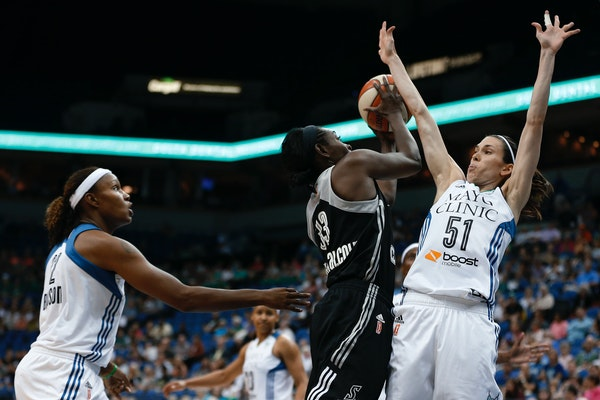 San Antonio Stars forward Sophia Young-Malcolm (33) tries to shoot against the defense of Minnesota Lynx guard Anna Cruz (51) during the first half of
