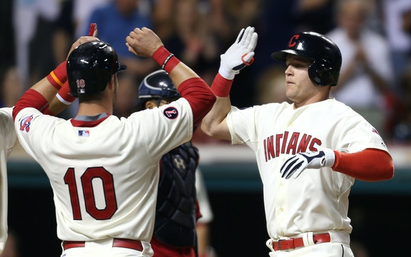 Cleveland Indians' Jerry Sands, right, gets congatulations from Yan Gomes after hitting a grand slam off Minnesota Twins relief pitcher Blaine Boyer d