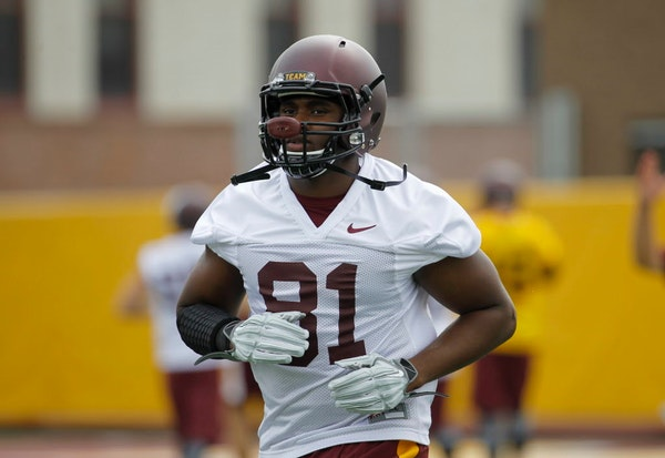 Minnesota tight end Duke Anyanwu (81) takes part in NCAA college football training camp in Minneapolis Friday, Aug. 7, 2015.