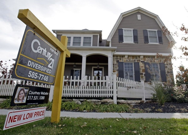 FILE - This Oct. 20, 2009, file photo, shows a home for sale in Carmel, Ind., neighborhood.