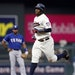 Minnesota Twins� Miguel Sano rounds the bases on a two-run home run off Texas Rangers pitcher Nick Martinez during the third inning of a baseball ga