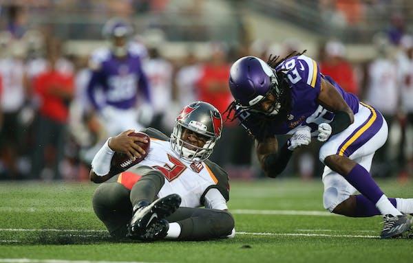 Vikings cornerback Trae Waynes hit Buccaneers quarterback Jameis Winston during a second-quarter scramble on Saturday night.