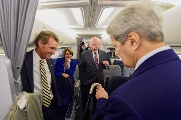 Sen.Amy Klobuchar on the State Department plane headed to Cuba with, from left, Sen. Jeff Flake of Arizon, Sen. Patrick Leahy of Vermont and Secretary