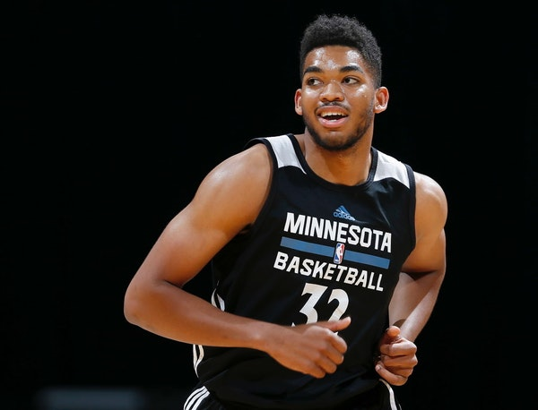 Karl-Anthony Towns may have appeared all by himself during Wednesday's scrimmage at the Target Center, but somewhere on his shoulder rests his imagina