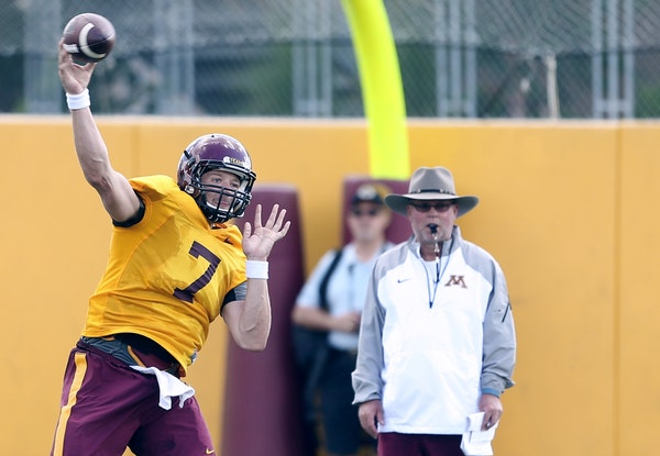 Quarterback Mitch Leidner threw a pass as coach Jerry Kill watched during practice earlier this month.