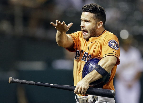 Houston Astros' Jose Altuve celebrates after scoring against the Oakland Athletics in the tenth inning of a baseball game Thursday, Aug. 6, 2015, in O