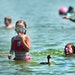 With temperatures in the 90s on Friday, even a duck decided to join in and cool off in the waters of Lake Nokomis in MInneapolis.