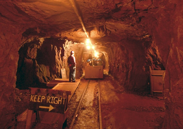 A train brings visitors three-fourths of a mile into a tunnel at Soudan Underground Mine State Park.
