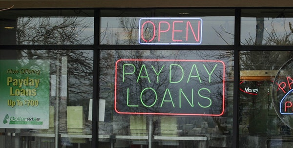 ** FILE ** In this Jan. 23, 2009, file photo a Dollarwise payday loan store is open in Kent, Wash.