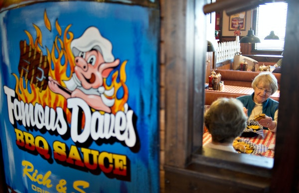 Customer Neta Moon, right, eats with a friend at a Famous Dave's restaurant.