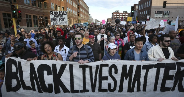 Protesters walked along Washington Avenue during a Black Lives Matter rally on April 29, 2015, in Minneapolis.