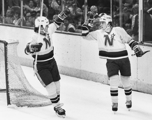 Neal Broten, right, and Dino Ciccarelli