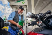 Bob Lodin filled his motorcycle with $2.39-per-gallon gas at a BP in south Minneapolis.