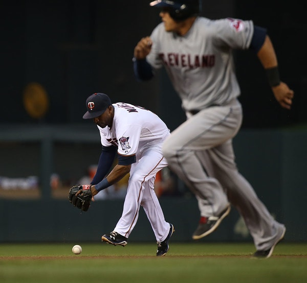 Twins Eduardo Nunez bobbled the ball hit by Cleveland's Lonnie Chisenhall in the fourth inning.