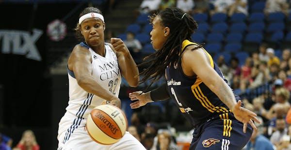 Minnesota Lynx forward Rebekkah Brunson (32) tries to pass the ball around Indiana Fever forward Erlanka Larkins during the first half of a WNBA baske