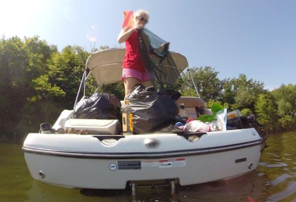 Volunteers cleaned up trash along Big Island on Lake Minnetonka.