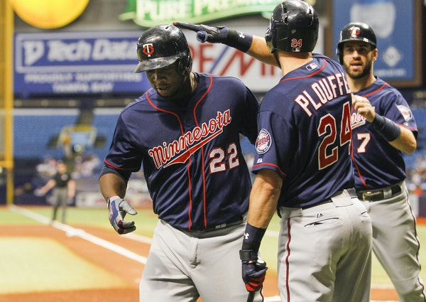 The Minnesota Twins' Trevor Plouffe (24) congratulates teammate Miguel Sano (22) on his three-run home run in the first inning against the Tampa Bay R