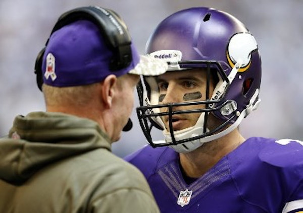 Former Vikings quarterback Christian Ponder, right, and offensive coordinator Bill Musgrave are now with Oakland and return to Minneapolis on Saturday