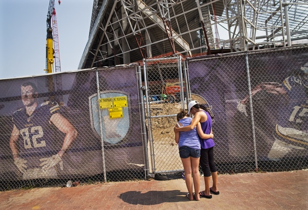 At U.S. Bank Stadium, one worker was killed and another injured in a construction site accident Wednesday morning. Angela Strong and daughter Kyra,11,