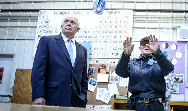 U.S. Rep. John Kline listened to John Parmeter, school safety and security officer, while on a tour of the troubled Bug-O-Nay-Ge-Shig school building