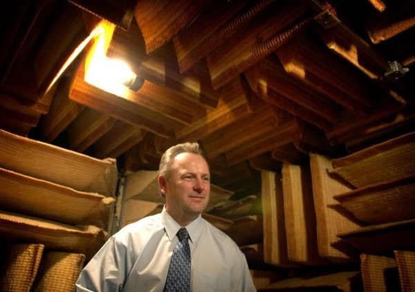 Former President Jerry Ruzicka, shown in 2006 in the company's soundproof room where hearing aides are tested, was one of four Starkey Hearing Technol