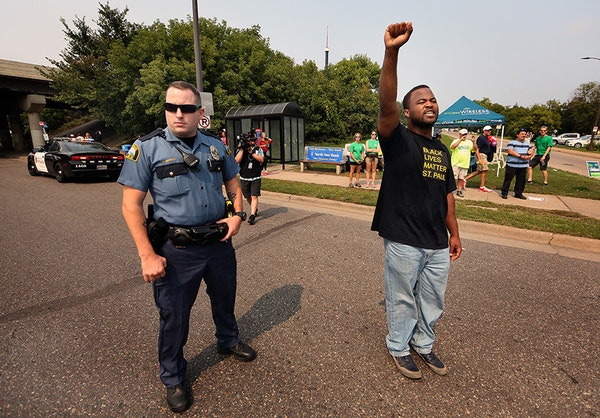Rashad Turner, lead organizer for Black Lives Matter St. Paul, lead the group down Como Ave.