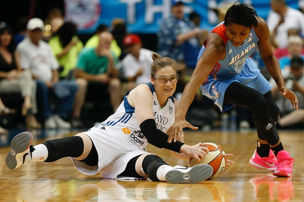 Lynx guard Lindsay Whalen, left, grabs the ball against Dream guard Angel McCoughtry during the first half of a WNBA basketball game, Friday, July 31,