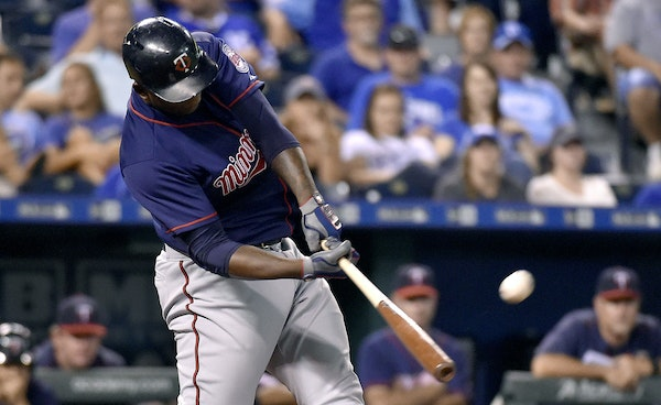 The Minnesota Twins' Miguel Sano connects on a solo home run in the 12th inning against the Kansas City Royals on Wednesday, Sept. 9, 2015, at Kauff