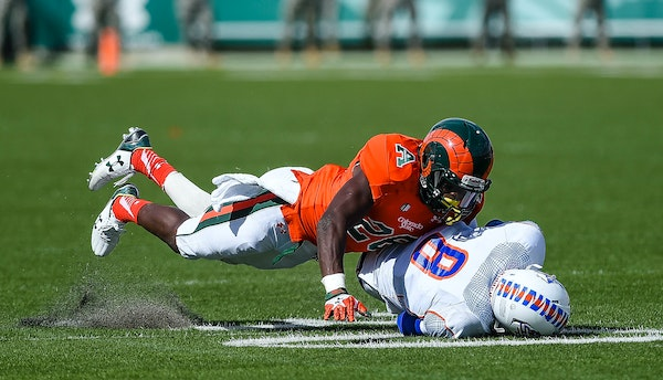 Colorado State's Kevin Pierre-Louis tackles Savannah State's Ker-Sean Wilson during an NCAA college football game, Saturday, Sept. 5, 2015, at Hughes