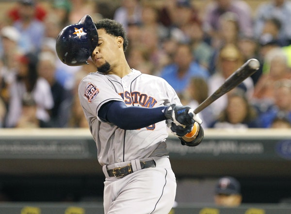 Astros outfielder Carlos Gomez lost his helmet as he swung through a Kyle Gibson pitch Friday night. In his second trip to Target Field this year, the