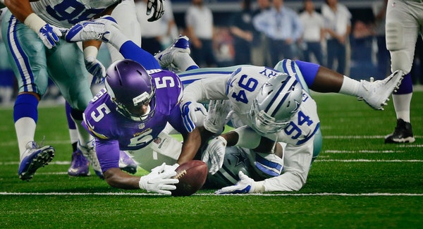 Minnesota Vikings quarterback Teddy Bridgewater (5) recovered his fumble from Dallas Cowboys defensive end Randy Gregory (94) in the first quarter. Th