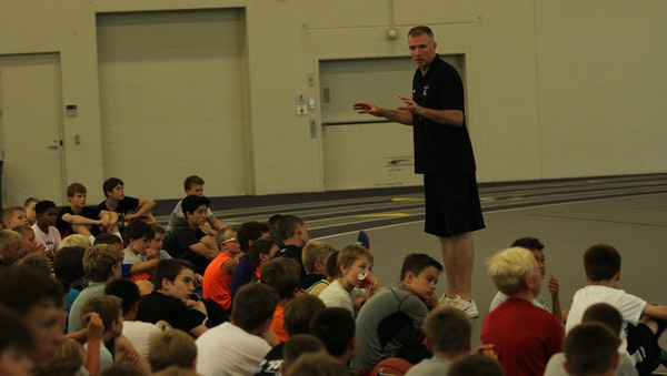 Author and University of St. Thomas men's basketball coach John Tauer at one of his youth basketball camps.