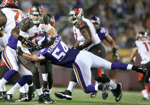 Vikings inside linebacker Eric Kendricks (54) sacked Buccaneers quarterback Seth Lobato in the fourth quarter during a preseason game.