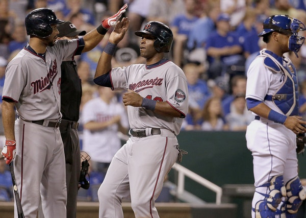 Torii Hunter celebrated with Aaron Hicks after Hunter scored on a single by Eduardo Escobar during the sixth inning Monday.