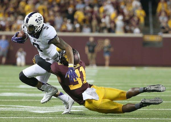 TCU wide receiver Josh Doctson is tackled by Minnesota Gophers defensive back Eric Murray in the season opener last week.
