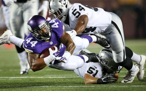 """Matt Asiata, picking up a first down against the Raiders on Saturday, has value that isn't lost on his offensive coordinator. """"He does everything"""