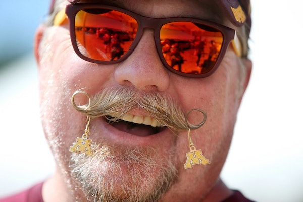 Scott Hasbrouck, who grew up in Minnesota but now lives in Thompson, North Dakota, sported jewelry on his mustache at a tailgate party to show support